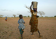 A woman pastoralist carrying water